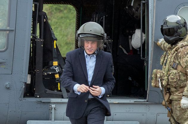 Williamson seen wearing an oversized helmet on a visit to a training area in