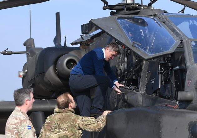 Williamson climbing into the cockpit of an Apache helicopter at Wattisham Airfield in Suffolk, as they...