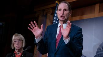 Sen. Ron Wyden, D-Ore., joined at left by Sen. Patty Murray, D-Ore., speaks during a news conference to press Congress to intervene on behalf of the Affordable Care Act, after a federal judge in Texas ruled it unconstitutional, on Capitol Hill in Washington, Wednesday, Dec. 19, 2018. (AP Photo/J. Scott Applewhite)