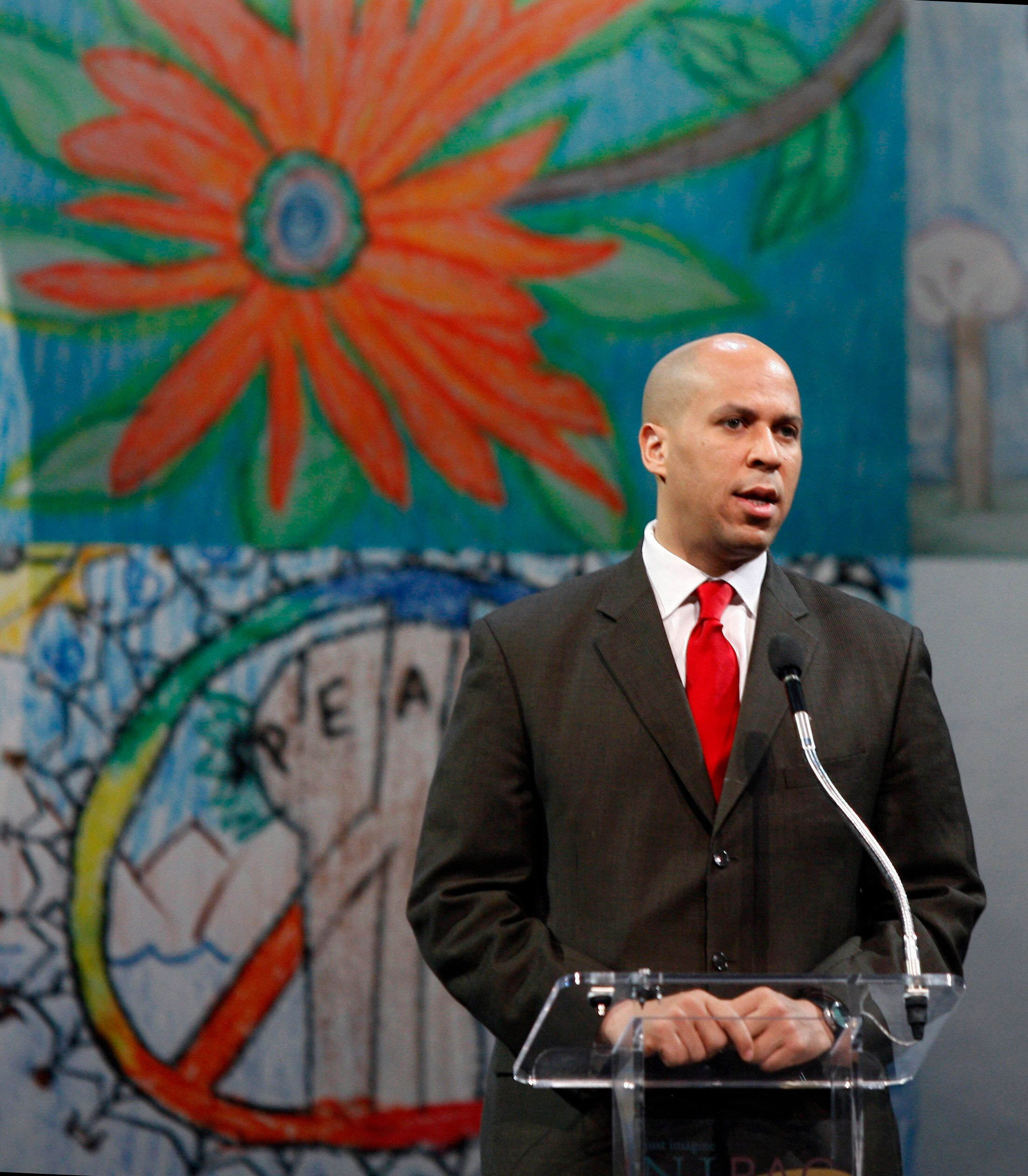 Newark Mayor Cory Booker opens the Newark Peace Education Summit early Friday, May 13, 2011, in Newark, N.J. The three-day summit on the power of nonviolence will include Nobel laureates, international leaders, local anti-violence activists and the Tibetan Buddhist spiritual leader the Dalai Lama. (AP Photo/Mel Evans)