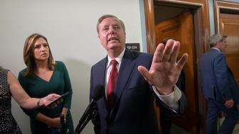 Senate Judiciary Committee Chairman Lindsey Graham, R-S.C., answers questions from reporters outside the hearing room after Attorney General William Barr testified about the Mueller report, on Capitol Hill in Washington, Wednesday, May 1, 2019. (AP Photo/J. Scott Applewhite)