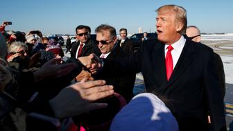 President Donald Trump shakes hands with supporters after arriving at Pittsburgh International Airport, Thursday, Jan. 18, 2018, in Pittsburgh. (AP Photo/Evan Vucci)