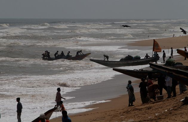 Sea fishing boats are seen at the Konark beach of Puri district and fishermen prepares to ashore their...