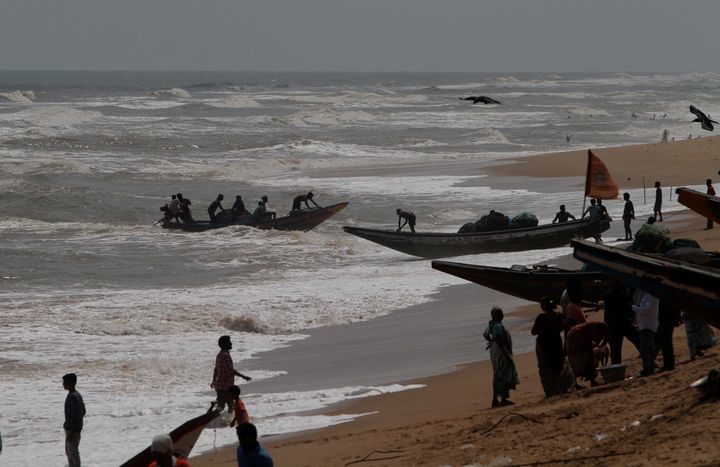 Sea fishing boats are seen at the Konark beach of Puri district and fishermen prepares to ashore their boats to the beach as they withdraw from the sea after cyclone 'Fani' alert.