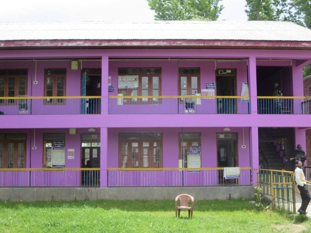 The bright pink-coloured higher secondary school where five polling stations have been set