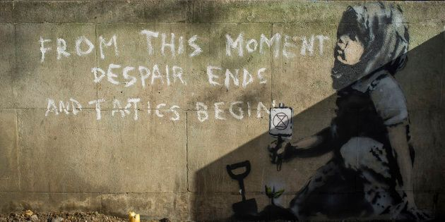 An art piece believed to be made by the English street artist Banksy is seen in Central London in tribute...
