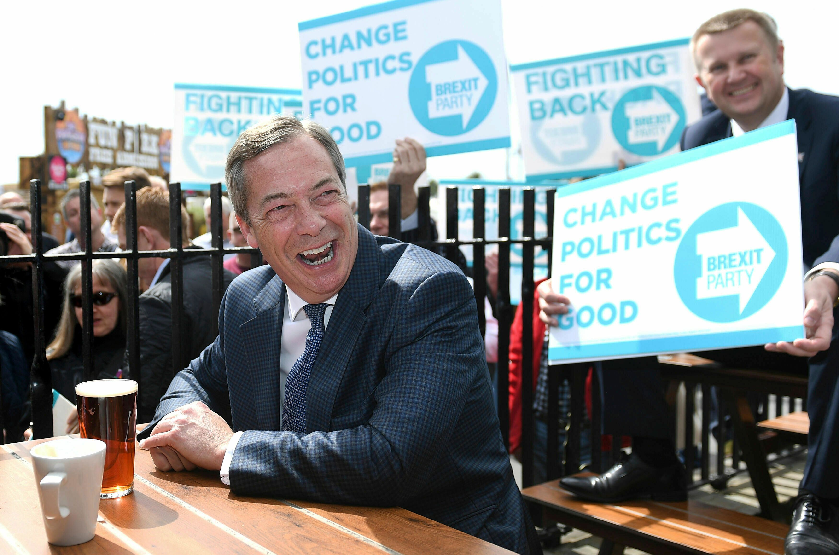 MEP, Nigel Farage reacts, at the Moon and Starfish public house during a walkabout and rally in Clacton, Essex, England for his Brexit Party Wednesday April 24, 2019. (Joe Giddens/PA via AP)