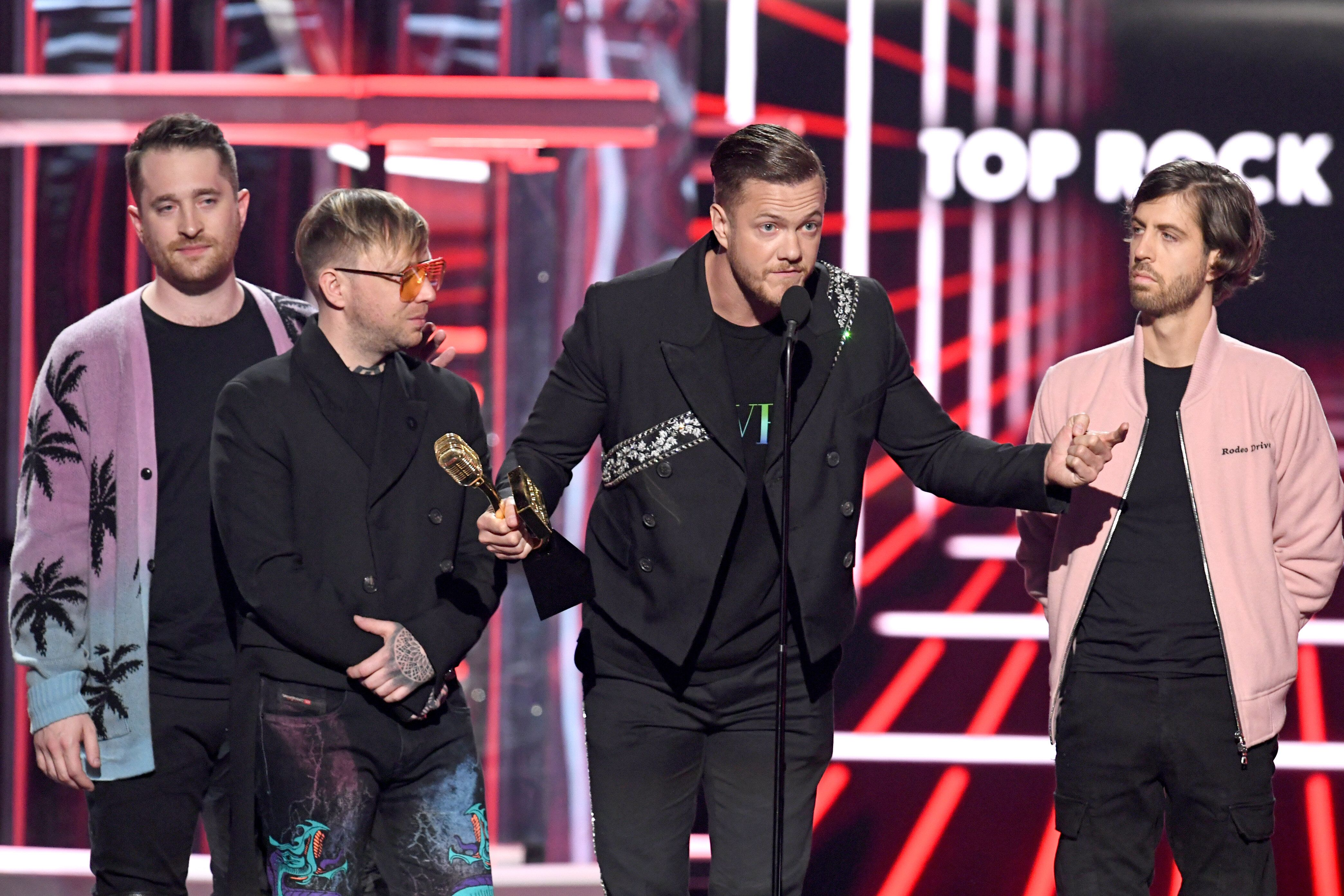 LAS VEGAS, NEVADA - MAY 01: (L-R) Daniel Platzman, Ben McKee, Dan Reynolds, and Wayne Sermon of Imagine Dragons accept the Top Rock Artist award onstage during the 2019 Billboard Music Awards at MGM Grand Garden Arena on May 01, 2019 in Las Vegas, Nevada. (Photo by Kevin Winter/Getty Images for dcp)