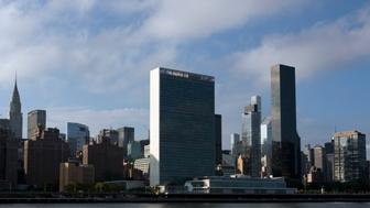 In this Oct. 10, 2018 photo, Trump World Tower, right, rises above the United Nations headquarters, center, in New York. Donald Trump's business ties to Saudi Arabia run long and deep, and he's often boasted about his business ties with the kingdom. Now those ties are under scrutiny as the president faces calls for a tougher response to the kingdom's government following the disappearance, and possible killing, of one of its biggest critics, journalist and activist Jamal Khashoggi. Trump said Friday that he will soon speak with Saudi Arabia's king about Khashoggi's disappearance.  (AP Photo/Mark Lennihan)