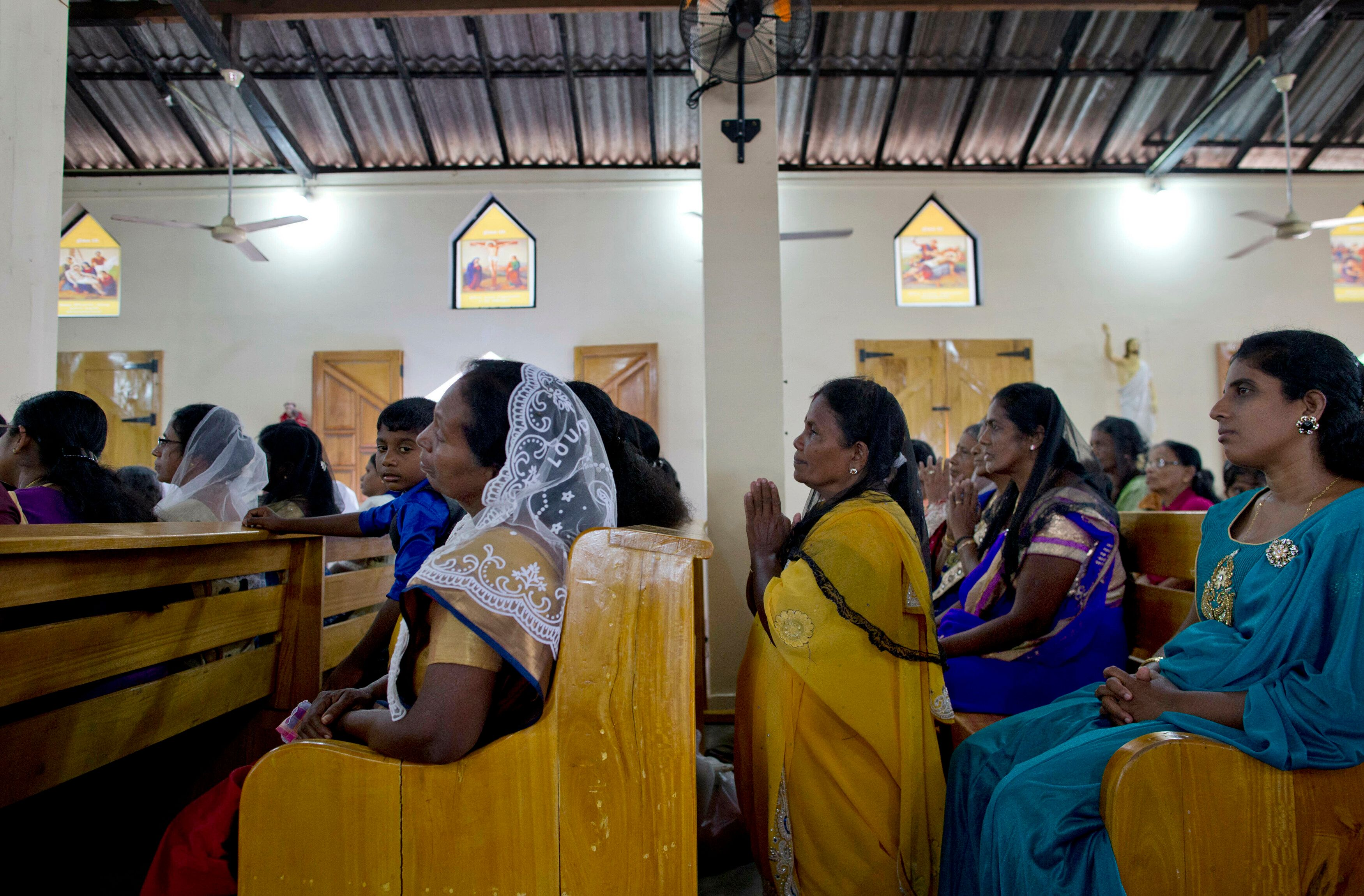 Catholics participate in Holy Mass at St. Joseph's church in Thannamunai, Sri Lanka, Tuesday, April 30, 2019. This small village in eastern Sri Lanka has held likely the first Mass since Catholic leaders closed all their churches for fear of more attacks after the Easter suicide bombings that killed over 250 people. (AP Photo/Gemunu Amarasinghe)