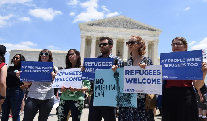 People protest the Muslim travel ban outside of the U.S. Supreme Court on June 26, 2018, in Washington.