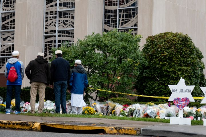 Muslim mourners stop in front of a makeshift memorial on Oct. 28, 2018, at the site of a mass shooting at the Tree of Life sy