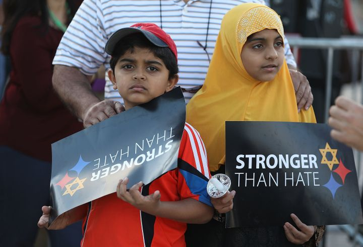 Children participate in a vigil in Miami on Oct. 30, 2018, in honor of the victims of a mass shooting at Pittsburgh's Tr