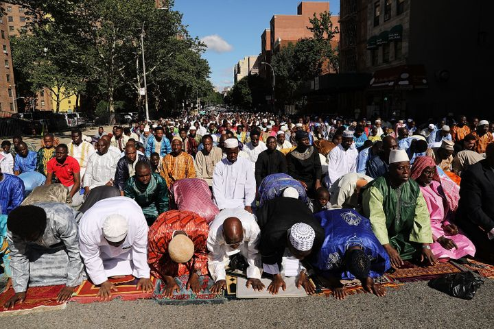 Muslims participate in an outdoor prayer event at Masjid Aqsa-Salam mosque, Manhattan's oldest West African mosque, to mark t