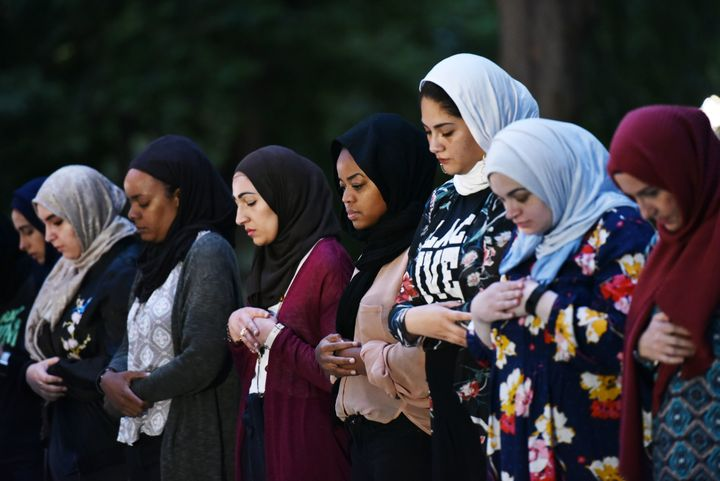 Women pray before iftar, the traditional Ramadan fast-breaking meal, at Lafayette Square during the Muslim holy month of Rama