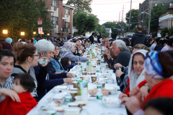 Muslims gather at an iftar dinner in the street organized by Bergen Diyanet Mosque and Cultural Center during the holy month