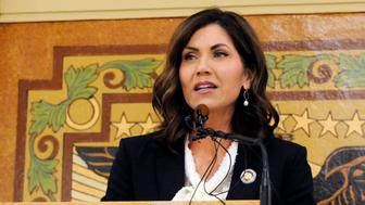 FILE - In this Jan. 8, 2019 file photo, South Dakota Gov. Kristi Noem gives her first State of the State address in Pierre, S.D. Noem says she's proposing legislation ahead of the Keystone XL oil pipeline's construction that would create a legal avenue to pursue out-of-state money that funds protests aimed at slowing construction. The Republican governor said Monday, March 4, 2019 that she wants to make sure Keystone XL and future pipelines are built safely and efficiently while shielding the state and counties from major law enforcement costs if there are riots. (AP Photo/James Nord, File)