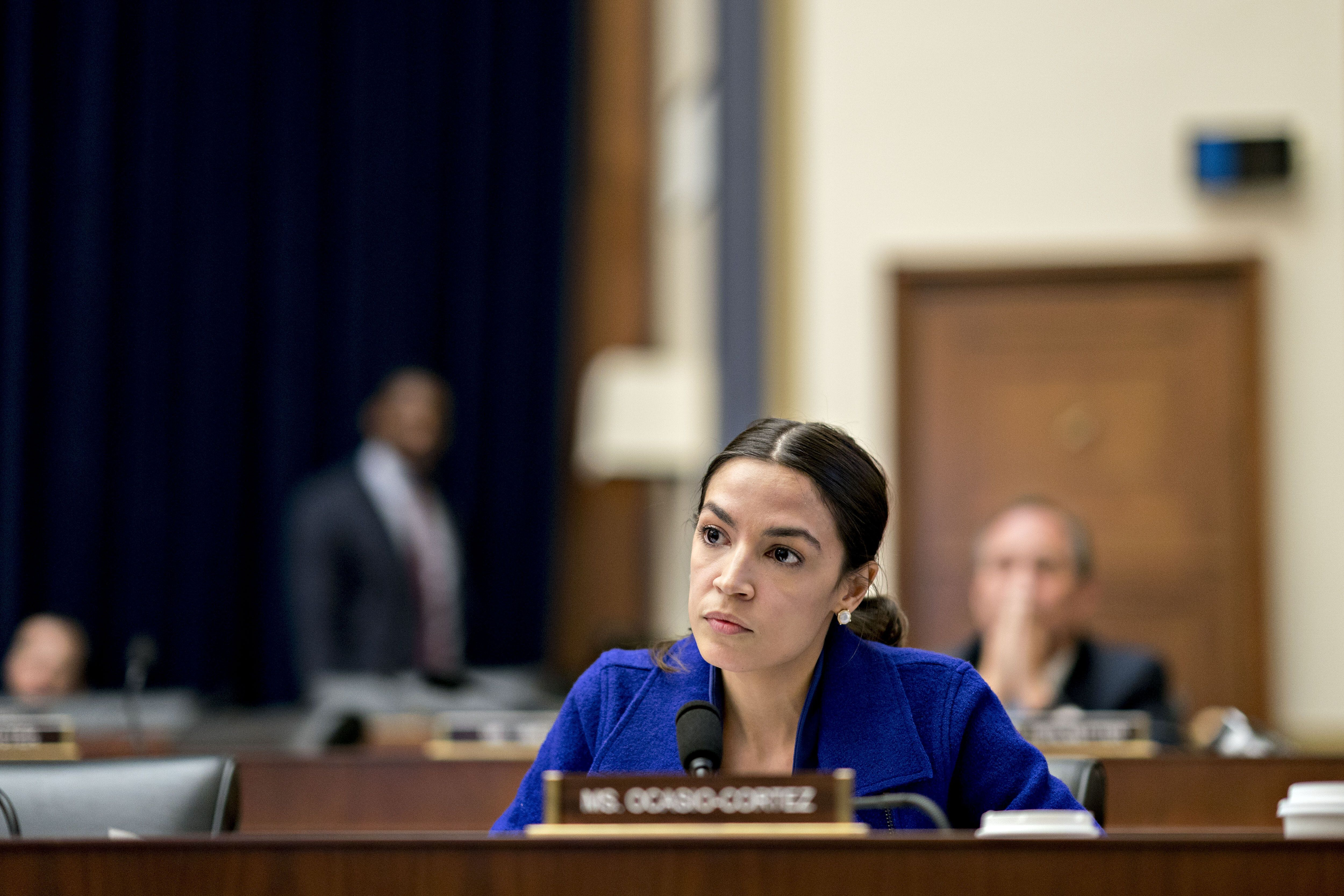 Representative Alexandria Ocasio-Cortez, a Democrat from New York, listens during a House Financial Services Committee hearing in Washington, D.C., U.S., on Wednesday, April 10, 2019. A decade after the financial crisis, the chiefs of the largest U.S. banks faced a grilling from lawmakers on everything from income inequality to their ties to politically controversial industries. Photographer: Andrew Harrer/Bloomberg via Getty Images