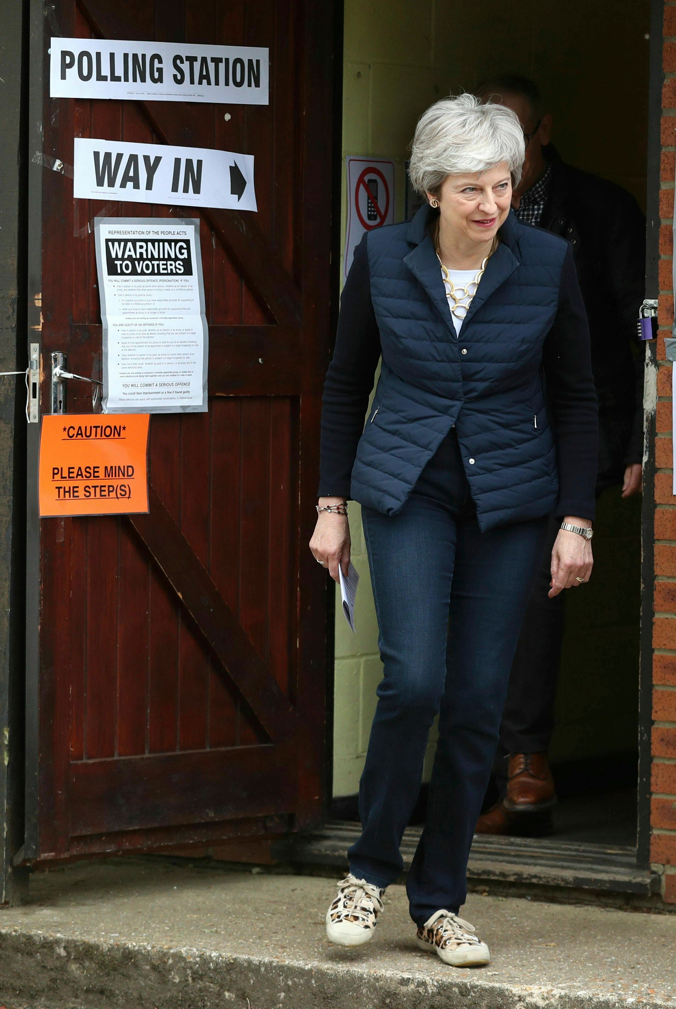 Britain's Prime Minister Theresa May leaves after casting her vote at a polling station near her home in Thames Valley, England, Thursday, May 2, 2019.  as voters headed to the polls for council and mayoral elections across England and Northern Ireland. (Andrew Matthews/PA via AP)