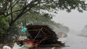 "Street shops are seen collapsed due to gusty winds ahead of the landfall of cyclone Fani on the outskirts of Puri, in the Indian state of Odisha, Friday, May 3, 2019. Indian authorities have evacuated hundreds of thousands of people along the country's eastern coast ahead of a cyclone moving through the Bay of Bengal. Meteorologists say Cyclone Fani was expected to make landfall on Friday with gale-force winds of up to 200 kilometers (124 miles) per hour likely starting Thursday night. It warned of ""extremely heavy falls"" over parts of the state of Odisha and its southern neighbor Andhra Pradesh. (AP Photo)"