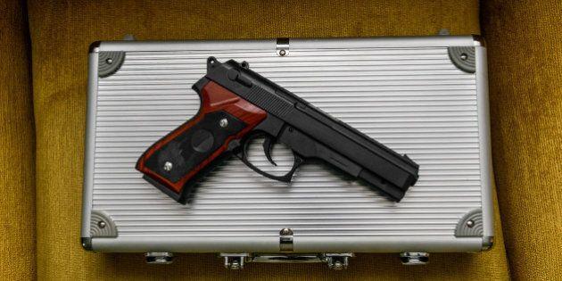 Pistol on a silver briefcase
