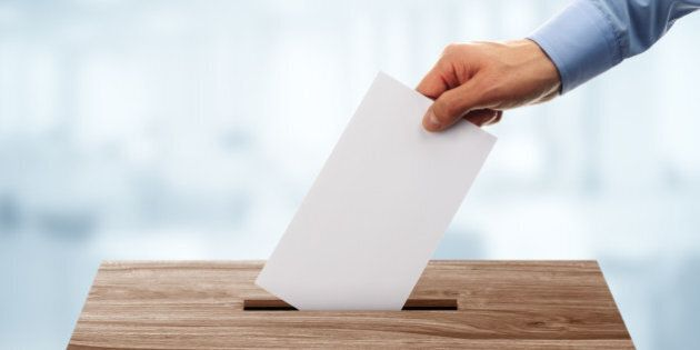 Ballot box with person casting vote on blank voting