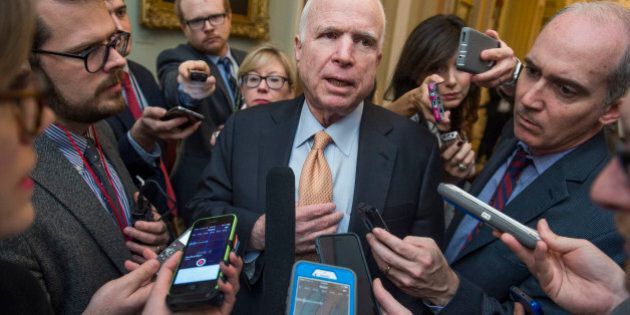 UNITED STATES - FEBRUARY 14: Sen. John McCain, R-Ariz., speaks with reporters after the Senate Policy...