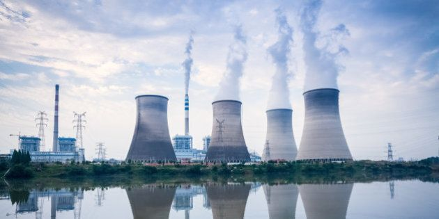 coal-fired power plant , cooling towers and river surface reflection , jiangxi ,