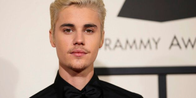 Singer Justin Bieber arrives at the 58th Grammy Awards in Los Angeles, California February 15, 2016....