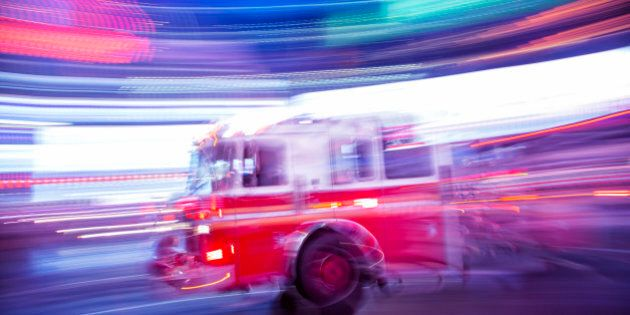Fire truck rushing down 7th Avenue at night, Times Square, Manhattan, New York City, long exposure