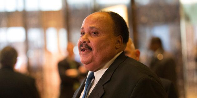 Martin Luther King III (center), an American human rights advocate, speaks to the press after meeting...