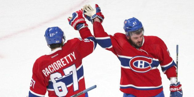 Apr 14, 2017; Montreal, Quebec, CAN; Montreal Canadiens right wing Alexander Radulov (47) celebrates his goal against New York Rangers with left wing Max Pacioretty (67) during an overtime period in game two of the first round of the 2017 Stanley Cup Playoffs at Bell Centre. Mandatory Credit: Jean-Yves Ahern-USA TODAY Sports