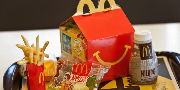 A Happy Meal is displayed for a photograph on a tray at a McDonald's Corp. restaurant in Little Falls, New Jersey, U.S., on Wednesday, Feb. 15, 2012. McDonald's Corp., the world's largest restaurant chain, said sales at stores open at least 13 months rose 6.7 percent globally last month as beverages and Chicken McBites helped the U.S. business. Photographer: Emile Wamsteker/Bloomberg via Getty Images