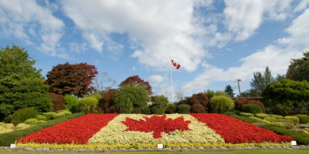 A Canadian flag made of flowers at the Peace Arch Border crossing between Canada and the United States,...