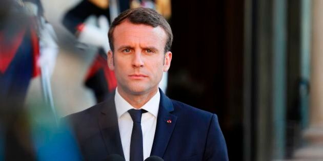 French President Emmanuel Macron listens as he deliver a joint press briefing with Italian Prime Minister...