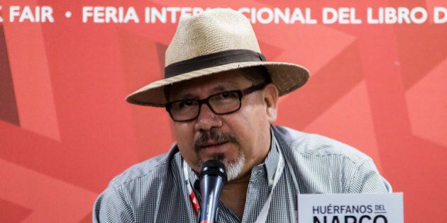 This file photo taken on November 27, 2016 shows Mexican journalist Javier Valdez speaking during the...