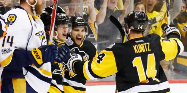 PITTSBURGH, PA - MAY 31:  Jake Guentzel #59 of the Pittsburgh Penguins celebrates with Conor Sheary #43 and Chris Kunitz #14 after scoring a goal during the first period in Game Two of the 2017 NHL Stanley Cup Final against the Nashville Predators at PPG Paints Arena on May 31, 2017 in Pittsburgh, Pennsylvania.  (Photo by Gregory Shamus/Getty Images)