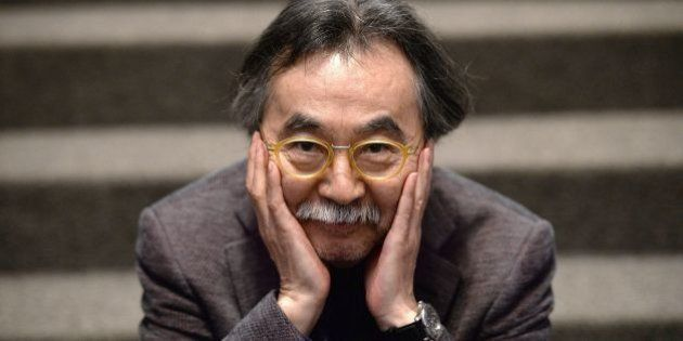 TO GO WITH AFP INTERVIEW by Karyn NISHIMURA-POUPEE Japanese cartoonist Jiro Taniguchi poses on January...