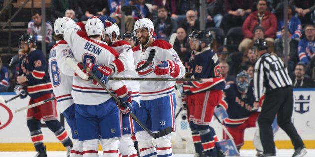 NEW YORK, NY - MARCH 04: Jordie Benn #8 of the Montreal Canadiens celebrates with teammates after scoring...
