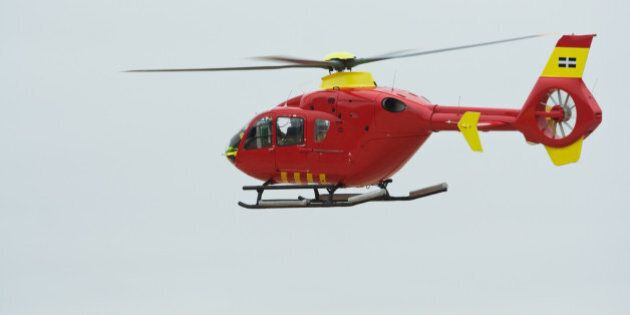 Air ambulance in flight over