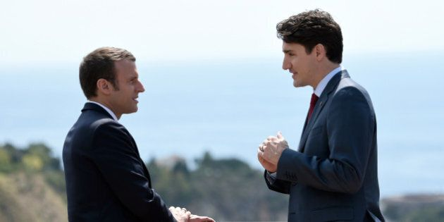 Canadian Prime Minister Justin Trudeau (R) and French President Emmanuel Macron talk as they attend the G7 Summit Taormina, Sicily, Italy, May 26, 2017. REUTERS/Stephane De Sakutin/Pool