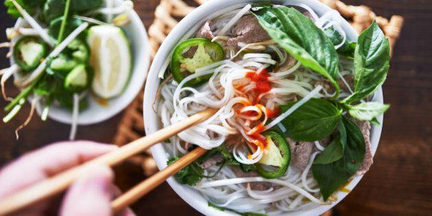 vietnamese pho with spicy sriracha sauce shot top