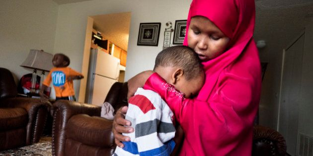 HOPKINS, MN - APRIL, 27: Suaado Salah comforts her son Luqman, 3, at their apartment in Hopkins, Minn.,...