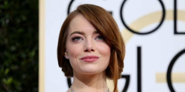 Actress Emma Stone arrives at the 74th Annual Golden Globe Awards in Beverly Hills, California, U.S.,...