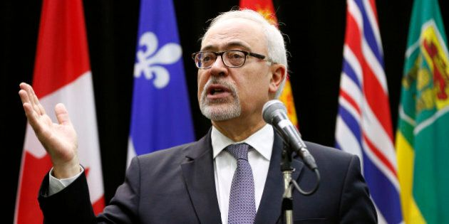 Quebec's Minister of Finance Carlos Leitao addresses the media before a meeting of Canada's Provincial...