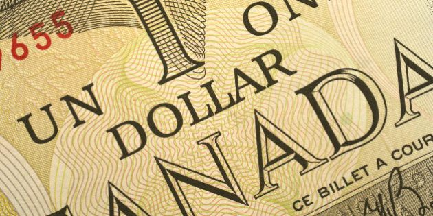 Closeup photo of a canadian dollar billAlso