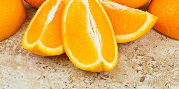 juicy covered orange segments on a textured