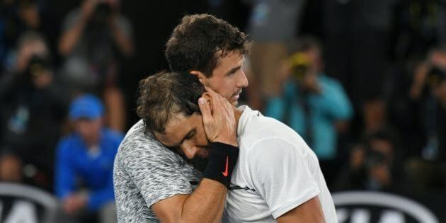 Spain's Rafael Nadal (R) is congratulated by Bulgaria's Grigor Dimitrov following Nadal's victory in...