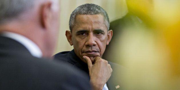 U.S. President Barack Obama, right, listens as Malcolm Turnbull, Australia's prime minister, speaks during...
