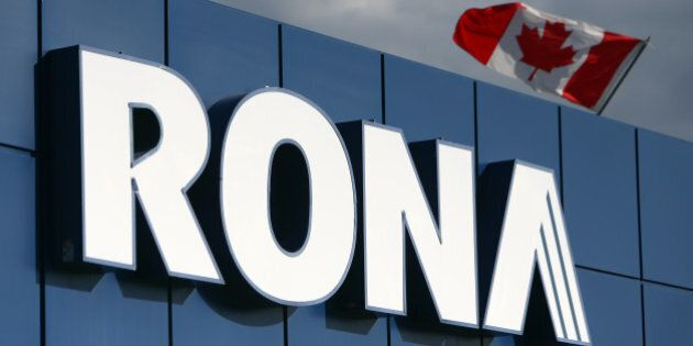 A Canadian flag flies over Rona Inc. signage displayed at the company's store in Toronto, Ontario, Canada,...